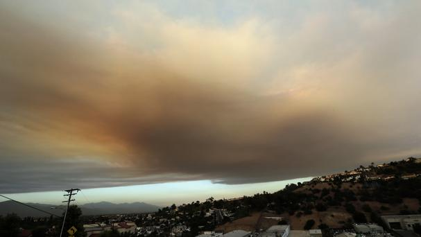 Smoke from a wildfire looms over Santa Clarita