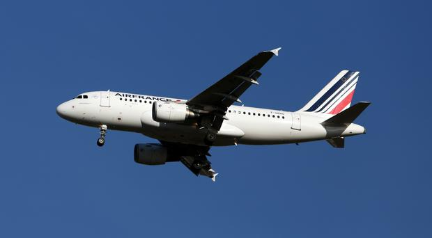 Air France warned of financial pressure amid concerns about the country as a tourist destination in the wake of deadly attacks