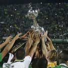 Members of Colombia's Atletico Nacional team hold the trophy aloft in Medellin, Colombia (AP)