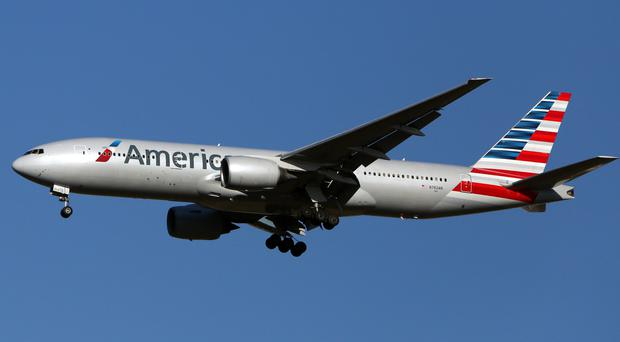 An American Airlines Boeing 777 lands at Heathrow Airport