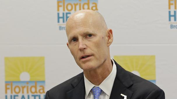 Rick Scott said health officials believe the infections occurred in a small area just north of central Miami (AP)