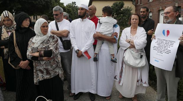Muslim worshippers gather in front of the memorial at the Saint Etienne church in Saint-Etienne-du-Rouvray, Normandy (AP)