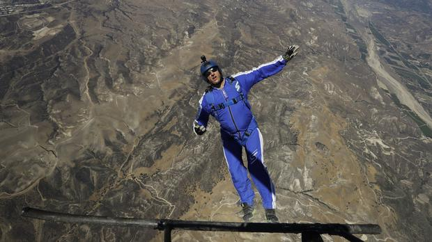 Skydiver Luke Aikins jumps from a helicopter during his training in Simi Valley, California (AP)