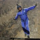 Luke Aikins jumps from a helicopter during his training in Simi Valley (AP)
