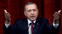 Recep Tayyip Erdogan has launched a sweeping crackdown on those he accuses of being involved in the July 15 attempted coup (AP)