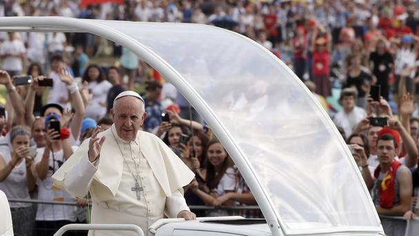 Pope Francis arrives to celebrate Mass at the World Youth Day in Krakow, Poland (AP)