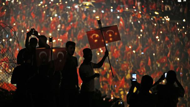 Pro-government supporters waving Turkish flags protest on the road leading to Istanbul's Bosphorus Bridge (AP)