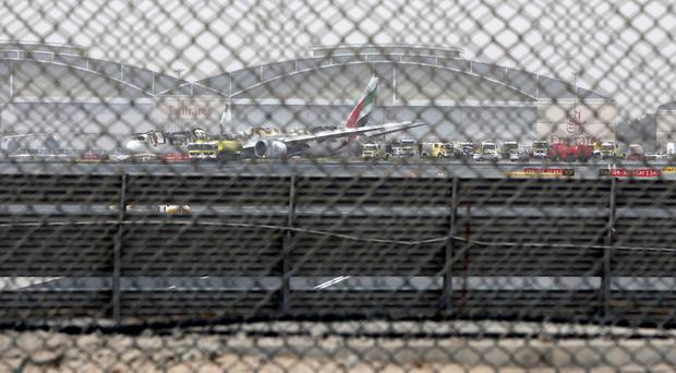 A damaged Boeing 777 is seen at Dubai airport after it crash-landed (AP)