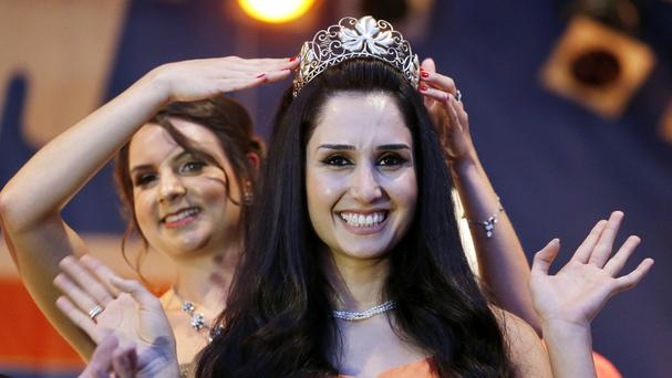 Ninorta Banho is the first former refugee in Germany to be crowned Wine Queen of Trier (AP)