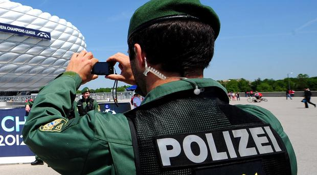 German police are trying to end a stand-off after an injured armed man barricaded himself in a restaurant in Saarbruecken