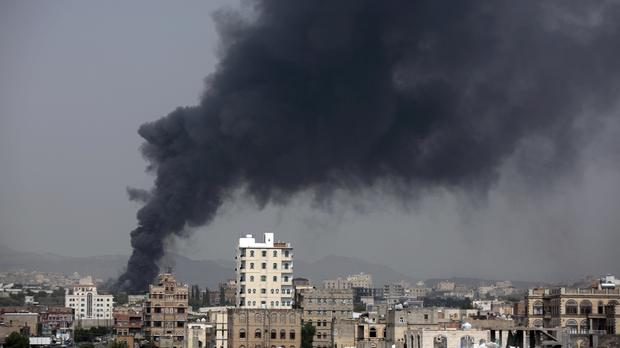Smoke rises after Saudi-led airstrikes hit a food factory in Sanaa, Yemen (AP)