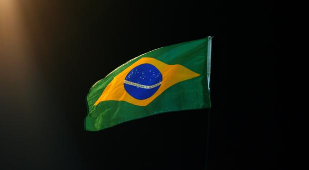 Brazil's Senate has voted to put suspended President Dilma Rousseff on trial