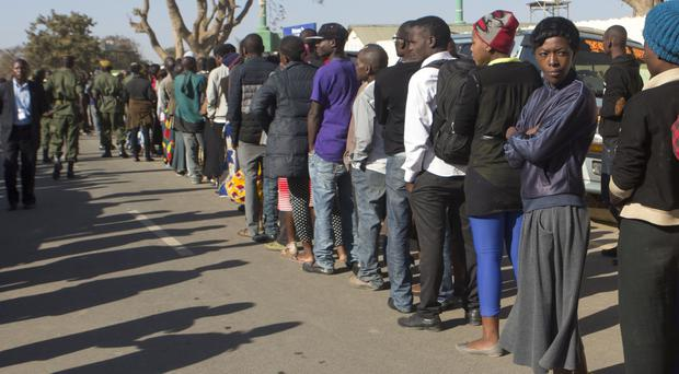 Zambians queue to vote in Lusaka in a tight election race for president and parliament (AP)