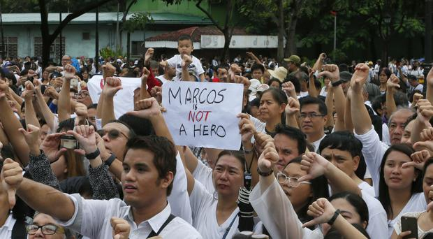 Protesters oppose the burial of Ferdinand Marcos at the Heroes' Cemetery
