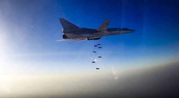 A Russian long-range bomber takes part in an air strike over Syria (Russian Defence Ministry Press Service photo via AP)
