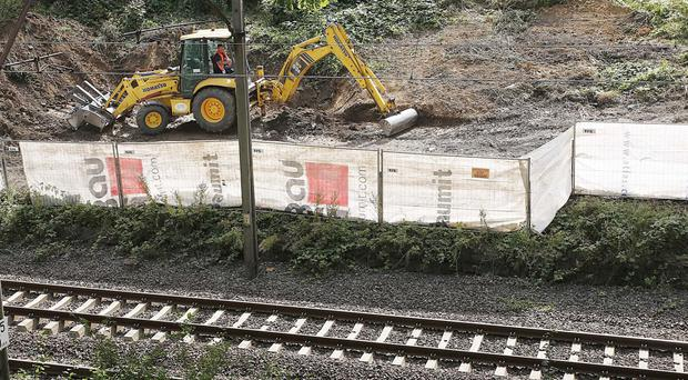 Heavy machinery begins the search to find a legendary Nazi train laden with treasure and armaments in Walbrych, Poland (AP)