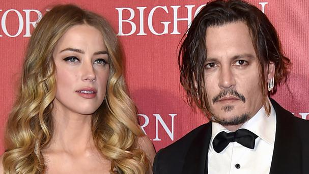 Amber Heard and Johnny Depp have settled their divorce case (Jordan Strauss/Invision/AP)
