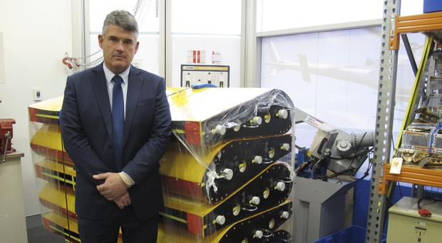 Peter Foley, Australian Transport Safety Bureau director of Flight 370 search operations, stands beside a stack of replica wing flaps (AP)