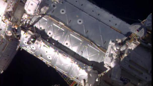 American astronauts taking a spacewalk outside the International Space Station (Nasa via AP)