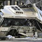 A bus is tipped on its side after two commuter buses collided in Newark, New Jersey (AP)
