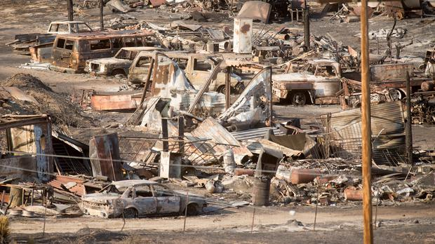 Cars and trailers destroyed by the Blue Cut fire in Phelan, California (AP)