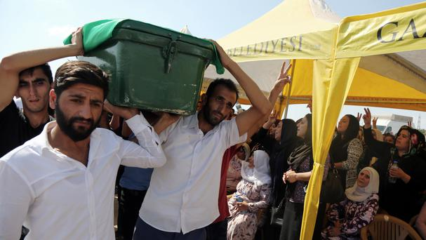 Mourners carry a victim's coffin as they attend funeral services for dozens of people killed in the bomb attack in Gaziantep (AP)