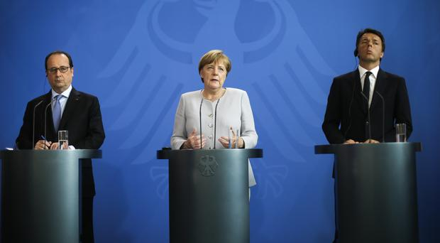 French President Francois Hollande, left, German Chancellor Angela Merkel and Italian PM Matteo Renzi are meeting in Italy (AP)