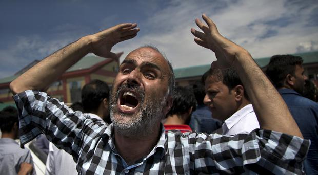 A Kashmiri Muslim man protesting outside a hospital in Srinagar. (AP)