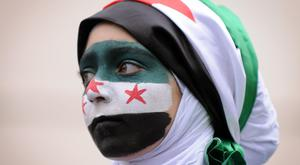A protester takes part in a demonstration against Syria's President Bashar Assad in central London
