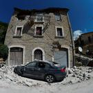 Rubble surrounds a damaged building yesterday in Pescara del Tronto
