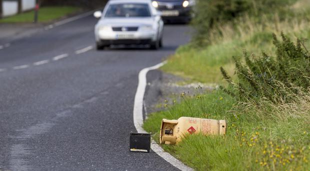 Hall Road remains open to traffic despite this suspect device lying on a grass verge