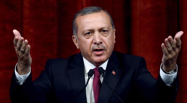 Attack comes after Turkey suffered its first loss of life since launching an operation in Syria (AP)