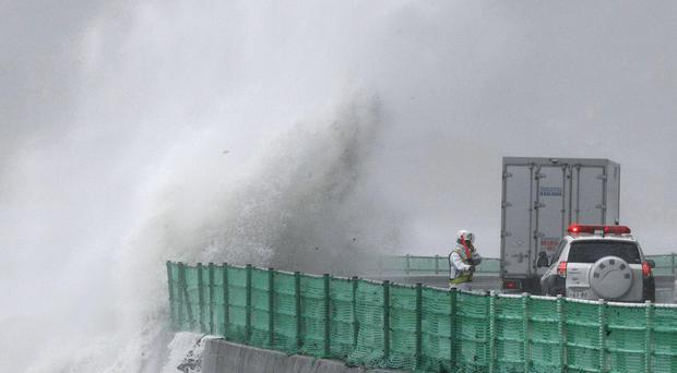 Typhoon Lionrock has paralysed traffic, caused blackouts and prompted officials to urge residents to evacuate (Kyodo News/AP)