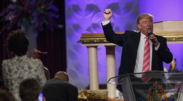 Donald Trump speaks during a church service at Great Faith Ministries in Detroit (AP)