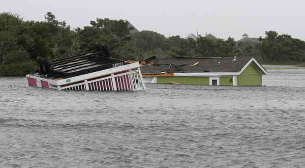 Trailers sit overturned in a creek after Hermine passed through (AP)