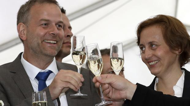 AfD candidate Leif-Erik Holm and member Beatrix von Storch toast the party's success in Schwerin (AP)