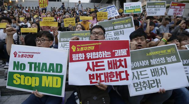 South Korean protesters march to oppose a deployment of the Terminal High-Altitude Area Defence system, or THAAD, in Seoul (AP)