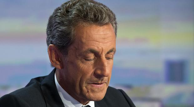 A Paris prosecutor has requested a criminal trial for former president Nicolas Sarkozy (AP)
