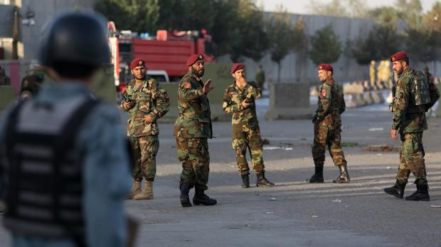 Soldiers and police at the scene of a suicide attack in Kabul (AP)