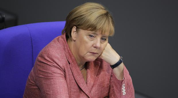 German Chancellor Angela Merkel said the country still has a lot to do to solve the migrants crisis (AP)