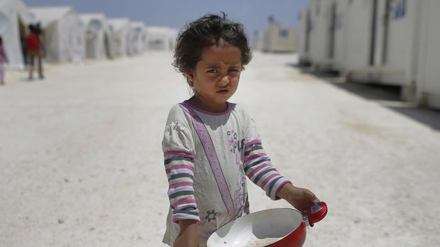 A Syrian refugee child (AP)