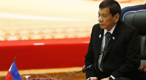 Rodrigo Duterte sits for the retreat session in the ongoing 28th and 29th ASEAN Summits at the National Convention Centre in Vientiane, Laos (AP)