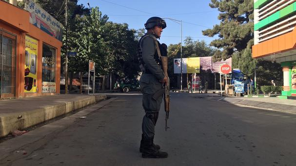 An Afghan police stands guard after an uptick in attacks in Kabul, Afghanistan (AP)