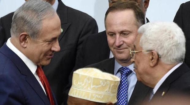 Israeli prime minister Benjamin Netanyahu, left, talks with Palestinian president Mahmoud Abbas in Paris last year (AP)