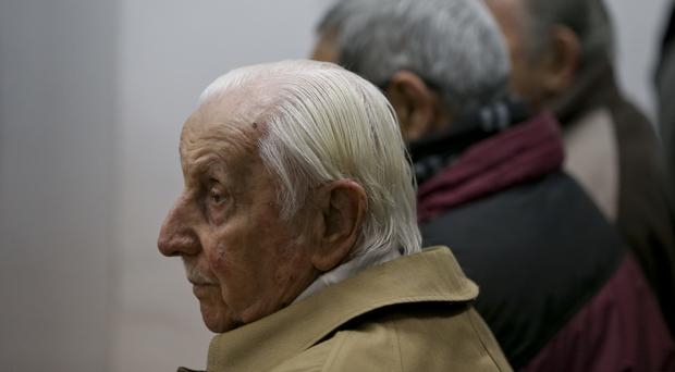 Omar Graffigna, who was head of the air force during Argentina's military dictatorship, attends his trial (AP)