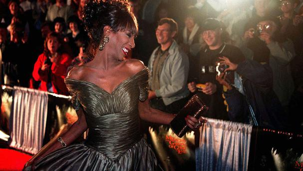 The Lady Chablis twirls for the crowd awaiting the stars of the film Midnight In The Garden Of Good And Evil (Scott Bryant/Savannah Morning News via AP)