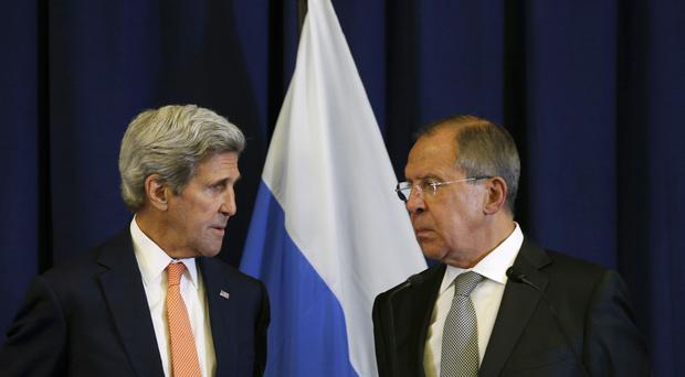 John Kerry and Sergey Lavrov during a press conference following their meeting in Geneva (AP)