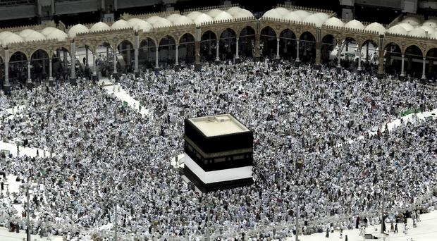 Muslim pilgrims at the Kaaba in Mecca (AP)