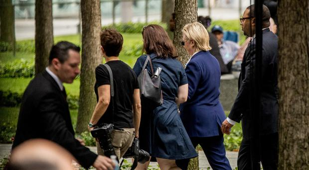 Hillary Clinton (second from right) leaving the ceremony in New York