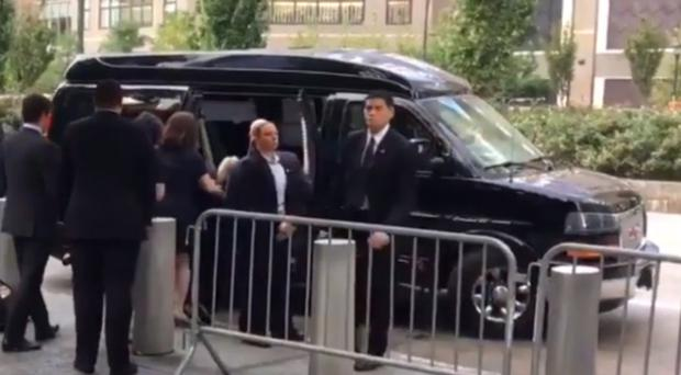 Hillary Clinton being carried into her car